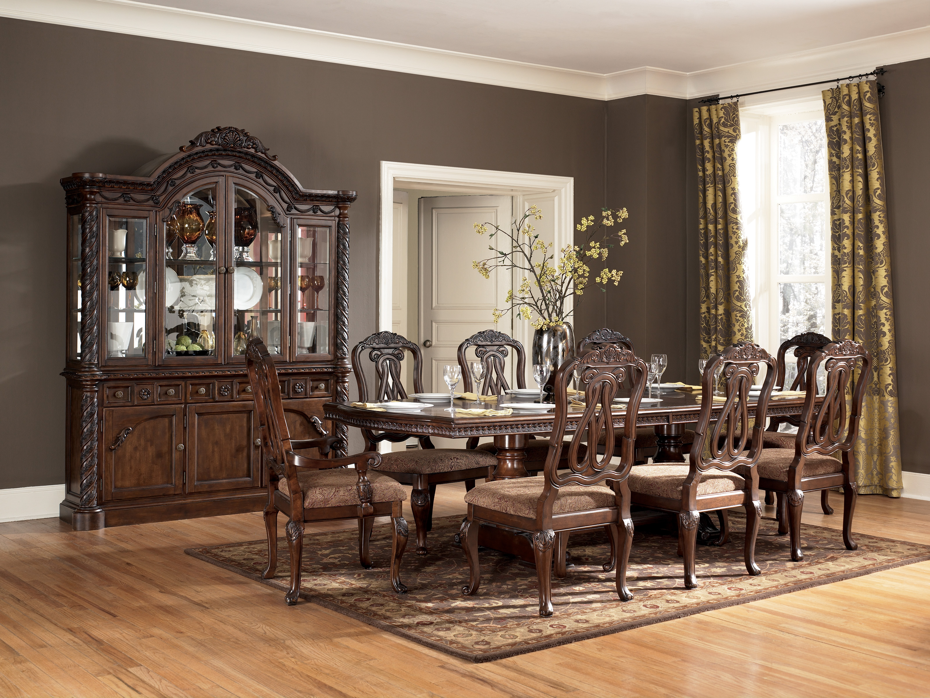 D553 Ashley Pedestal Dining Table | Zarco Furnishings
